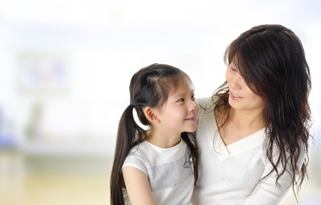 13548076 - asian mother and her daughter having conversation in home