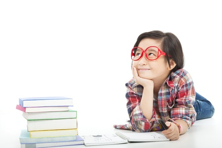 16574292 - asian little girl  thinking  during preparing homework