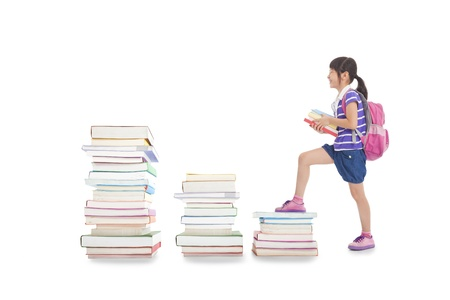 21492415 - happy little girl with backpack walking to the top of books