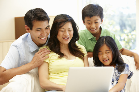 42108887 - asian family with laptop