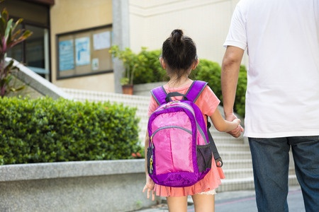43145928 - father walking to school with children