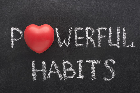 59632754 - powerful habits phrase handwritten on blackboard with heart symbol instead of o