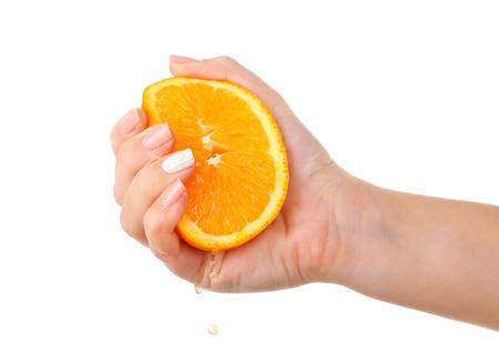 39136639 - female hand squeezing orange isolated on white